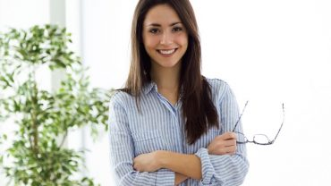 Portrait of business young woman looking at camera in the office.